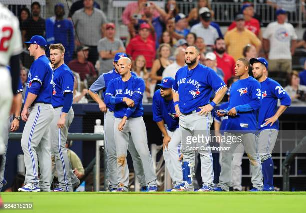 Members of the Toronto Blue Jays retreat from an eighth inning scuffle against the Atlanta Braves at SunTrust Park on May 17 2017 in Atlanta Georgia