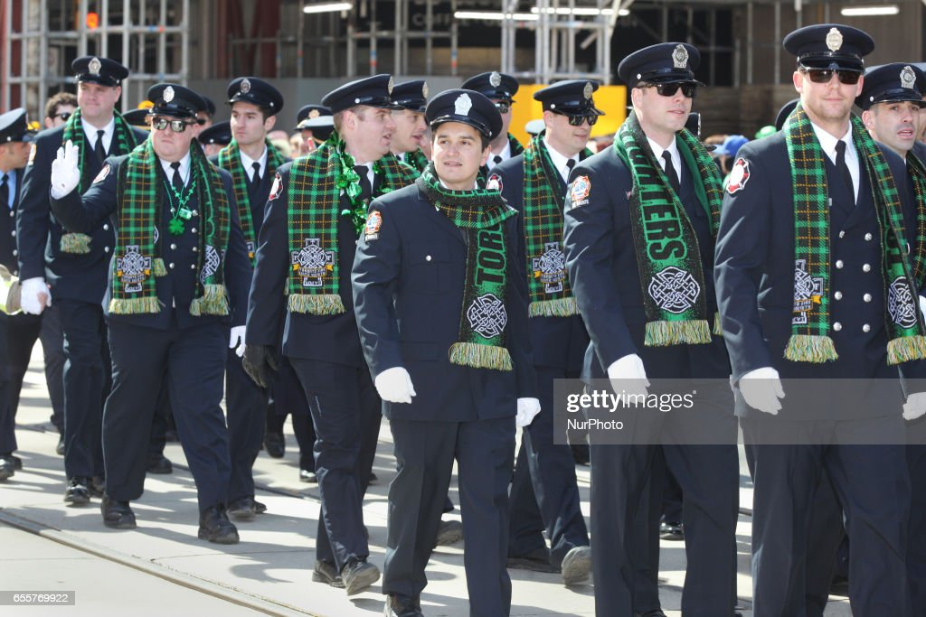 Members of the Toronto Fire Celtic Society march during the St. Patrick's Day Parade in Toronto, Ontario, Canada, on March 19, 2017.