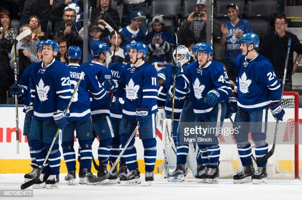 Members of the Toronto Maple Leafs celebrate after defeating the New Jersey Devils at the Air Canada Centre on March 23 2017 in Toronto Ontario Canada