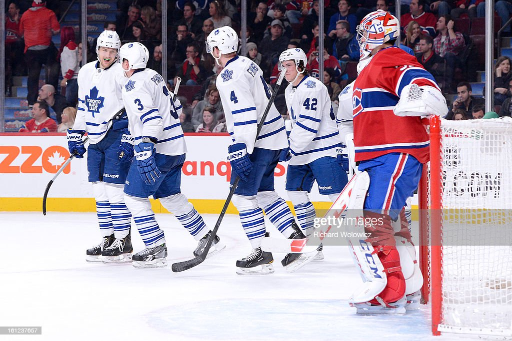 Members of the Toronto Maple Leafs celebrate their fourth goal of the evening in front of Carey Price #31 of the Montreal Canadiens during the NHL game at the Bell Centre on February 9, 2013 in Montreal, Quebec, Canada.