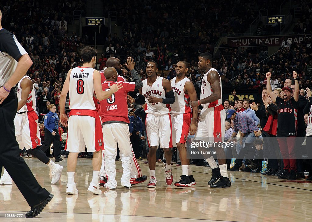 Members of the Toronto Raptors congradulate eachother during a timeout against the Portland Trail Blazers during the game on January 2, 2013 at the Air Canada Centre in Toronto, Ontario, Canada.