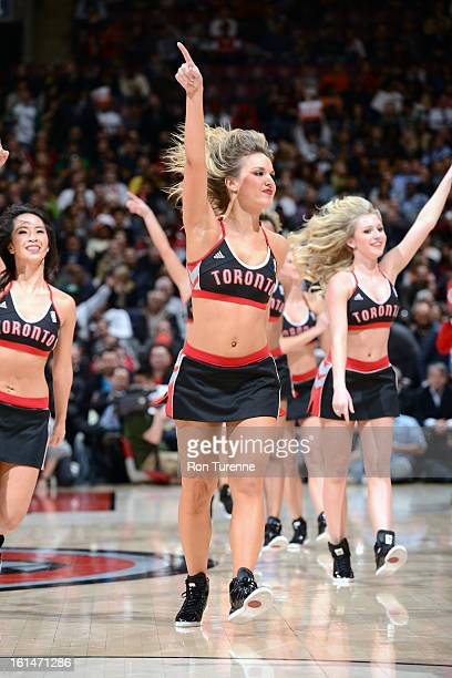 Members of the Toronto Raptors Dance Team gets the crowd pumped up against the Boston Celtics during the game on February 6 2013 at the Air Canada...