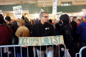 Members of the Transportation Union Local 100 and supporters from 'Occupy Wall Street' participate in a protest before marching to Zuccotti Park to...