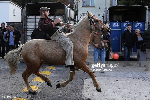 Members of the travelling community participate in bareback racing on their horses at the annual Ballinasloe Horse Fair on October 4 2015 in Galway...