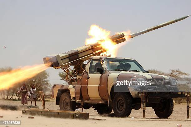 Members of the tribes and popular committees loyal to Yemen's Saudiback fugitive President Abderabbo Mansour Hadi launch rockets against positions of...