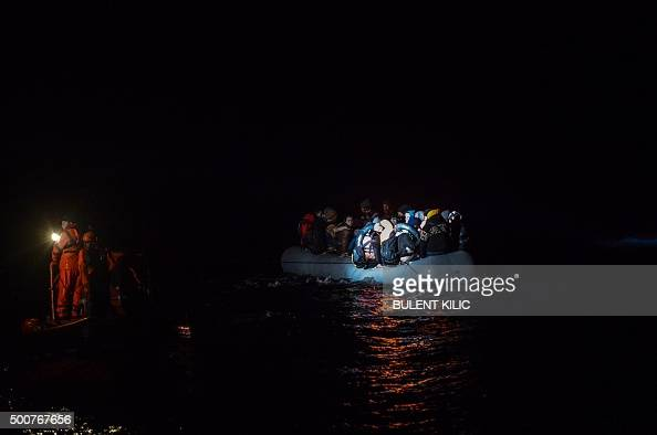 Members of the Turkish Coast Guard rescue Syrian migrants aboard an inflatable dinghy attempting to reach the Greek island of Chios on the Agean Sea...