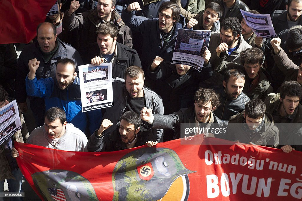 Members of the Turkish Communist Party demonstrate outside a hotel in Istanbul, Turkey, March 19, 2013, where Syrian opposition leaders elected a prime minister. Some Turkish parties are opposed to the support the Turkish government has provided to the rebels fighting the government of Syrian president Bashar Assad.