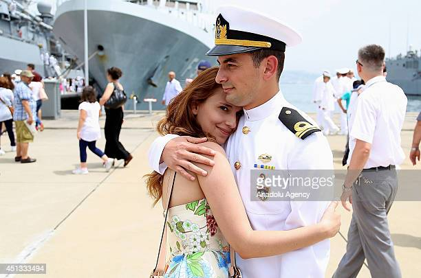 Members of the Turkish Maritime Task Group Barbaros are welcomed upon their arrival at Golcuk Naval Base in Kocaeli Turkey on June 27 2014 Turkish...