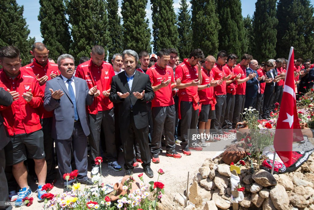 Members of the Turkish national football team visit the cemetery in Soma to pray at the graves of miners who lost their lives in an explosion at Soma...