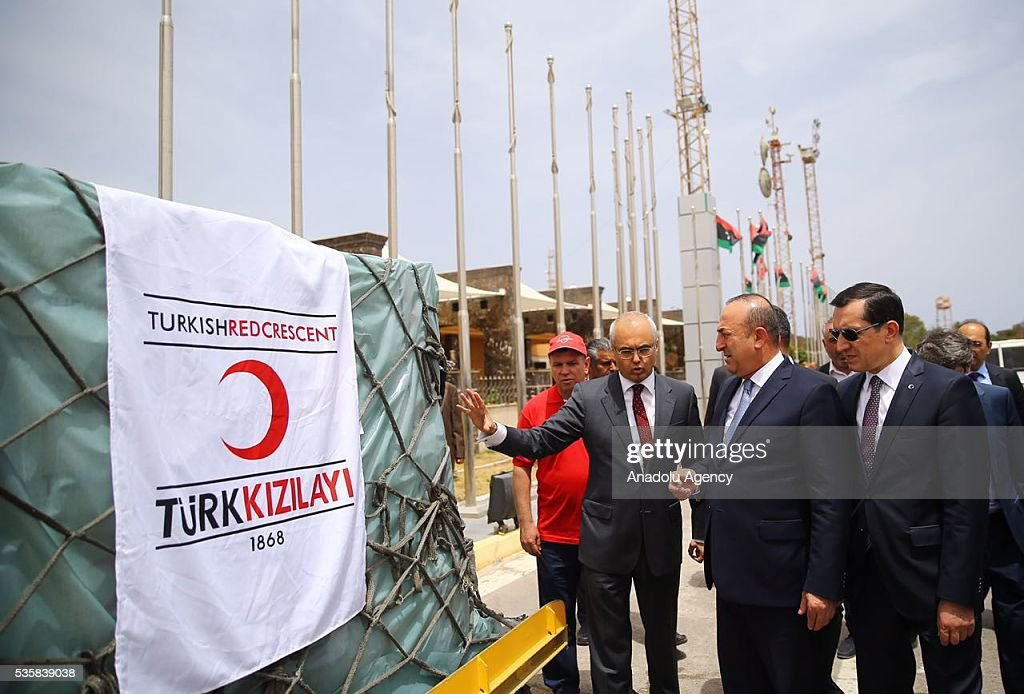 Members of the Turkish Red Crescent in Libya informs Turkish Foreign Minister Mevlut Cavusoglu upon his arrival in Tripoli, Libya on May 30, 2016.