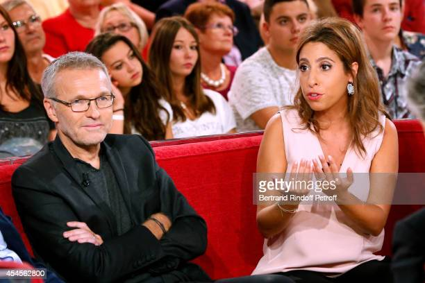 Members of the TV show 'On est pas couche' Laurent Ruquier and Lea Salame attend the 'Vivement Dimanche' French TV Show at Pavillon Gabriel on...