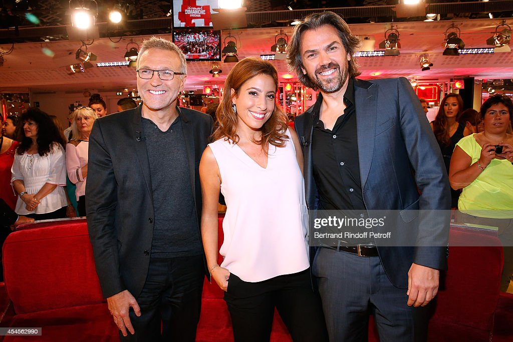 Members of the TV show 'On est pas couche' <a gi-track='captionPersonalityLinkClicked' href=/galleries/search?phrase=Laurent+Ruquier&family=editorial&specificpeople=2825920 ng-click='$event.stopPropagation()'>Laurent Ruquier</a>, Lea Salame and Aymeric Caron attend the 'Vivement Dimanche' French TV Show at Pavillon Gabriel on September 3, 2014 in Paris, France.
