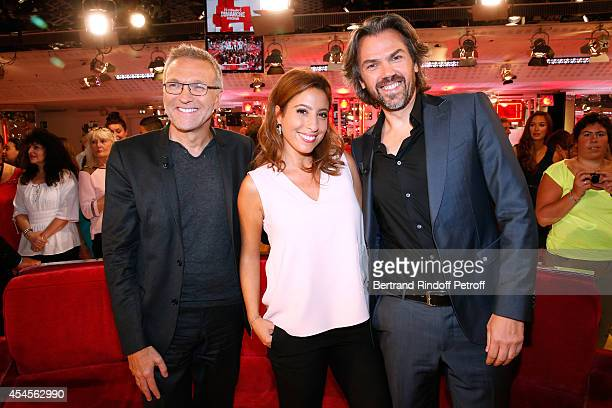 Members of the TV show 'On est pas couche' Laurent Ruquier Lea Salame and Aymeric Caron attend the 'Vivement Dimanche' French TV Show at Pavillon...