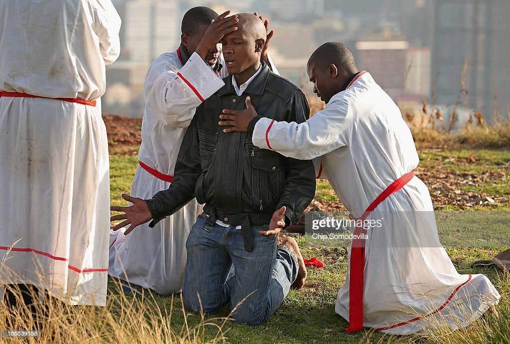 Members of the Twelve Apostles Church of Christ pray on a hill in the Yeoville neighborhood April 4, 2013 in Johannesburg, South Africa. Members of the church, many of them immigrants from Zimbabwe, gather in the open on the hill overlooking downtown Johannesburg because they say the Bible tells the faithful to go to the mountaintop to pray. According to government officials, Noble Peace Prize laureate and former South African President Nelson Mandela, 94, contiunes to recover from pneumonia after spending more than a week in the hospital, his third time since December.