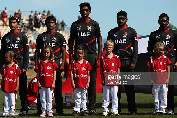 Members of the UAE cricket team during national anthems at the 2015 ICC Cricket World Cup match between Zimbabwe and the United Arab Emirates at...