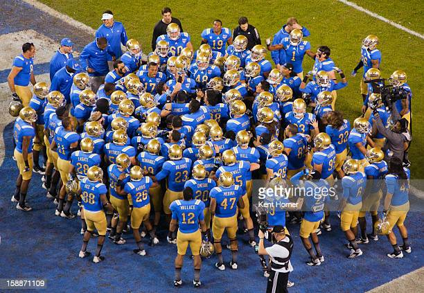 SAN DIEGO CA DECEMBER 27 Members of the UCLA Bruins football team huddle together after pregame warmup drills before leaving the field prior to the...