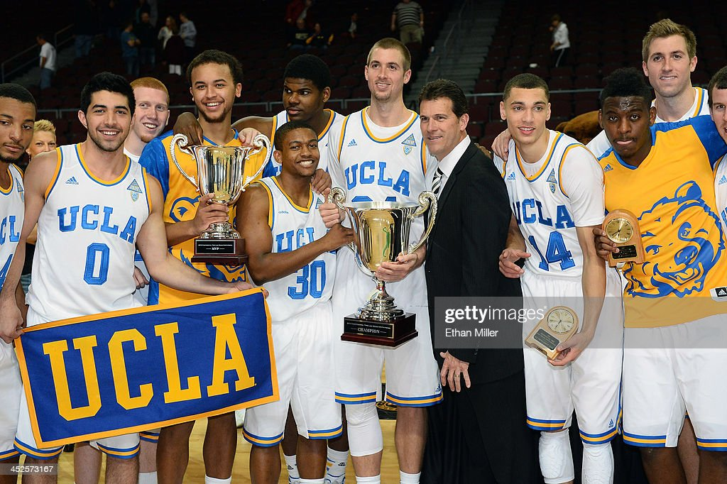 Members of the UCLA Bruins, including head coach <a gi-track='captionPersonalityLinkClicked' href=/galleries/search?phrase=Steve+Alford&family=editorial&specificpeople=233486 ng-click='$event.stopPropagation()'>Steve Alford</a>, pose with the championship trophy after defeating the Northwestern Wildcats 95-79 during the Continental Tire Las Vegas Invitational at the Orleans Arena on November 29, 2013 in Las Vegas, Nevada.