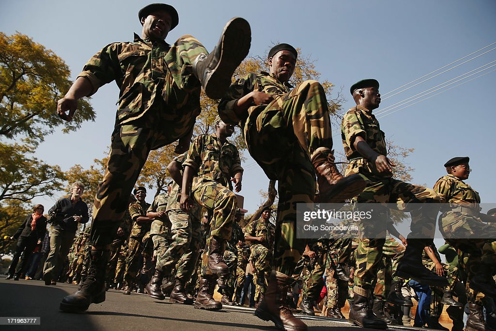Members of the Umkhonto We Sizwe Military Veterans Association sing and dance outside the Mediclinic Heart Hospital where former South African President Nelson Mandela is being treated for a recurring lung infection June 30, 2013 in Pretoria, South Africa. The anti-apartheid icon and Nobel Peace Prize laureate has been in the hospital for three weeks where his condition has been described as 'critical but stable.'