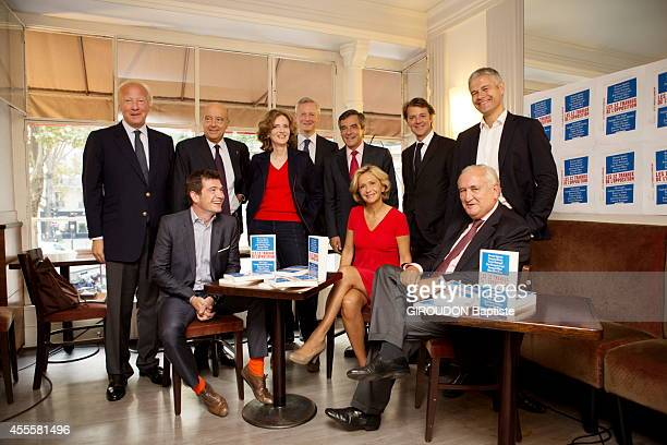 10 members of the UMP pose for the release of a common book Project pour redresser la France JeanFrancois Cope Xavier Bertrand Brice Hortefeux Alain...