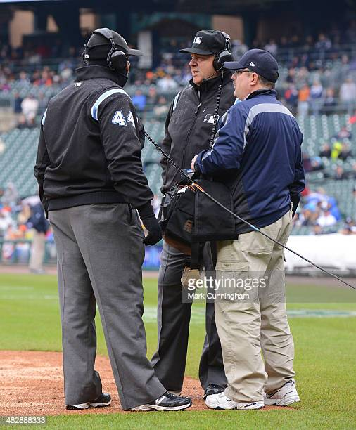 Members of the umpire crew and a MLB replay technician stand on the field for a instant replay review during the game between the Baltimore Orioles...