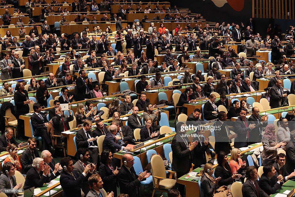 Members of the UN General Assembly applaud as Mahmoud Abbas, President of the Palestinian National Authority, arrives to speak before a vote on Palestinian 'non-member status' on November 29, 2012 in New York City. The General Assembly was set to approve the implicit recognition of Palestinian statehood despite opposition from the United States, Israel and a handful of other members.