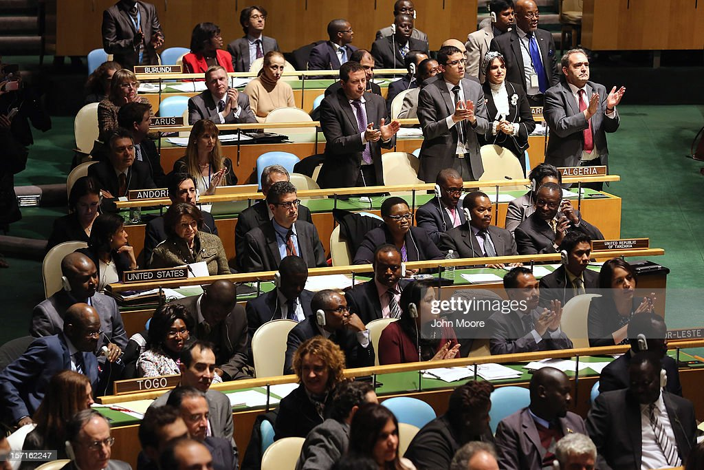Members of the UN General Assembly, including the United States delegation, watch as Mahmoud Abbas, President of the Palestinian National Authority, arrives to speak before a vote on Palestinian 'non-member status' on November 29, 2012 in New York City. The General Assembly was set to approve the implicit recognition of Palestinian statehood despite opposition from the United States, Israel and a handful of other members.