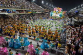 Members of the Uniao da Ilha samba school fourth in the 2014 Rio Carnival perform during the Champions' parade of the carnival's victorious samba...