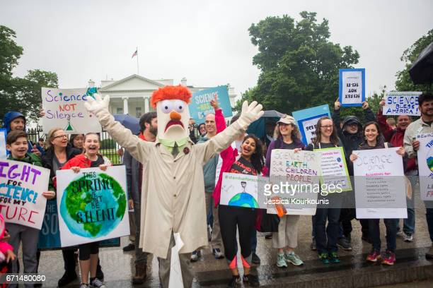 Members of the Union for Concerned Scientists pose for photographs with Muppet character Beaker in front of The White House before heading to the...
