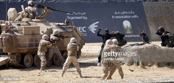 Members of the United Arab Emirates' armed forces take part in a military show launching the International Defence Exhibition and Conference at the...