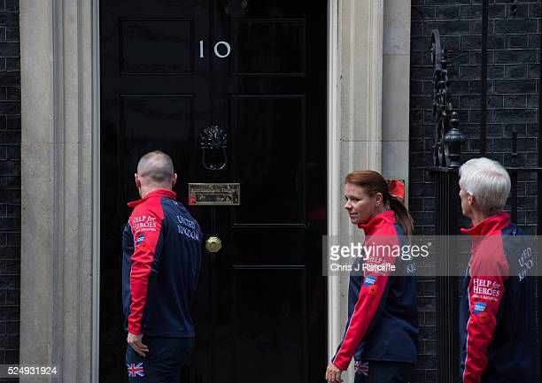 Members of the United Kingdom team attending the Invictus Games arrive at 10 Downing Street before meeting British Prime Minister David Cameron on...
