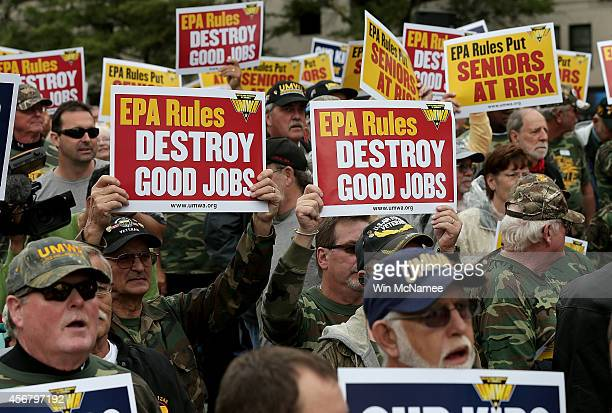 Members of the United Mine Workers of America rally outside of the headquarters of the Environmental Protection Agency October 7 2014 in Washington...