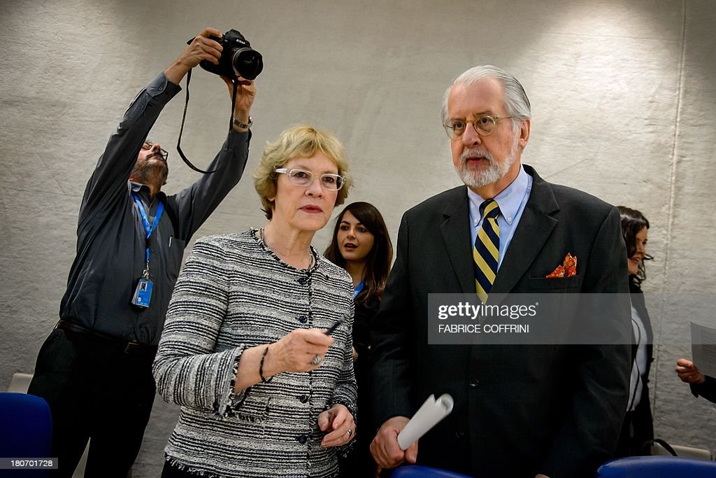 Members of the United Nations (UN) Commission of Inquiry on Syria, Karen Koning Abuzayd (L) of the United Statees and Chairman Paulo Sergio Pinheiro of Brazil, prepare on September 16, 2013 for the presentation of their report before Human Rights Council's members in Geneva. Chemical weapons attacks are a war crime, a UN-mandated investigator told the world body's top human rights forum, slamming a litany of abuses in war-torn Syria.