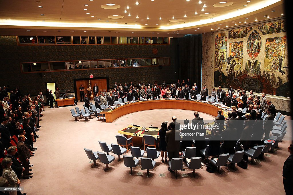 Members of the United Nations Security Council pause during a moment of silence for victims of the downed Malaysia Airlines passenger jet during an...