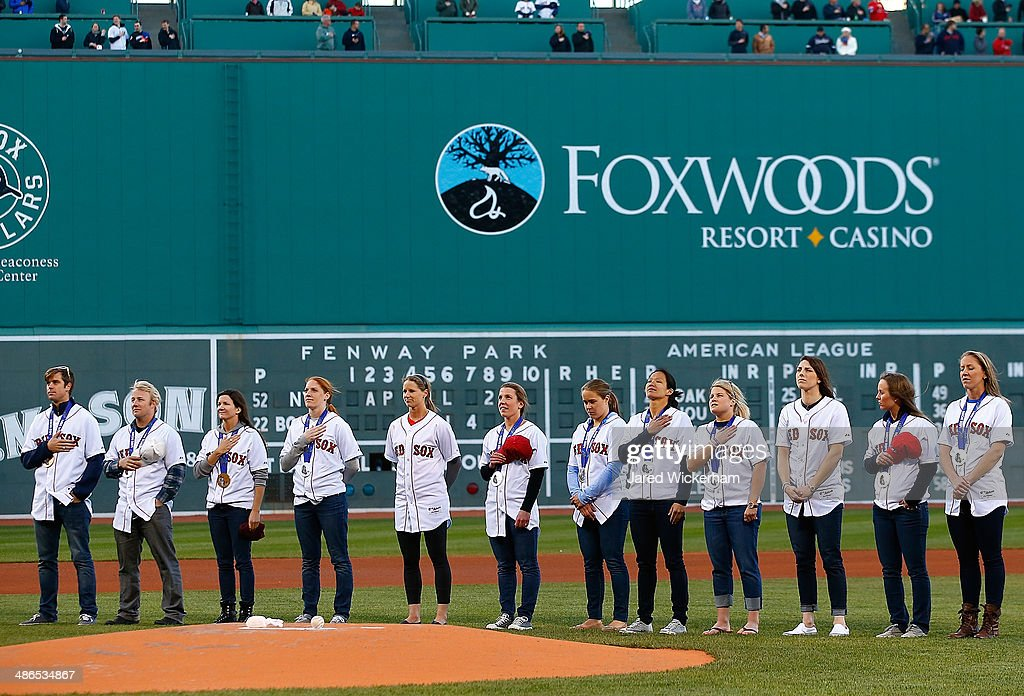 Members of the United States 2014 Sochi Winter Olympic team from the New England area listen to the national anthem prior to the game between the Boston Red Sox and the New York Yankees at Fenway Park on April 24, 2014 in Boston, Massachusetts.