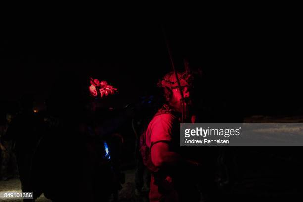 Members of the United States Army Special Forces Operational Detachment Alpha prepares for a casevac night training of Afghanistan Special Forces on...