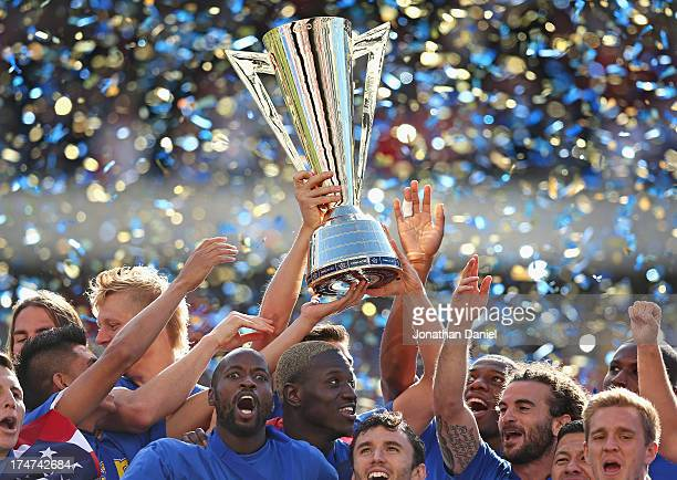Members of the United States celebrate winning the Gold Cup after defeating Panama during the CONCACAF Gold Cup final match at Soldier Field on July...
