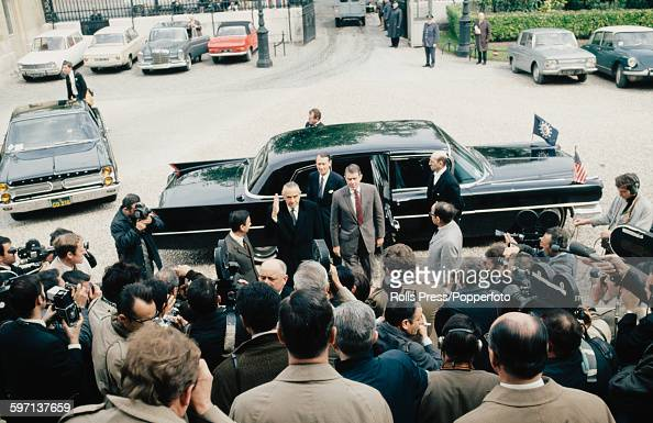 Members of the United States diplomatic delegation led by W Averell Harriman and Cyrus Vance emerge from their limousine as they arrive for initial...