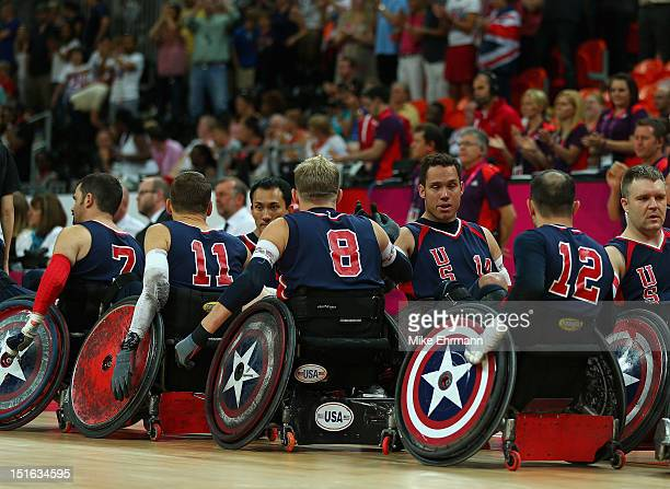 Members of the United States high five after winning the Bronze Medal match of Mixed Wheelchair Rugby against Japan on day 11 of the London 2012...