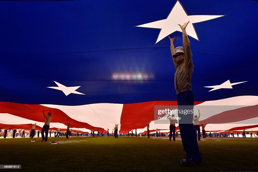 Members of the United States Marine Corps hold a giant flag while the National Anthem is sung before the Nebraska Cornhuskers and the USC Trojans...