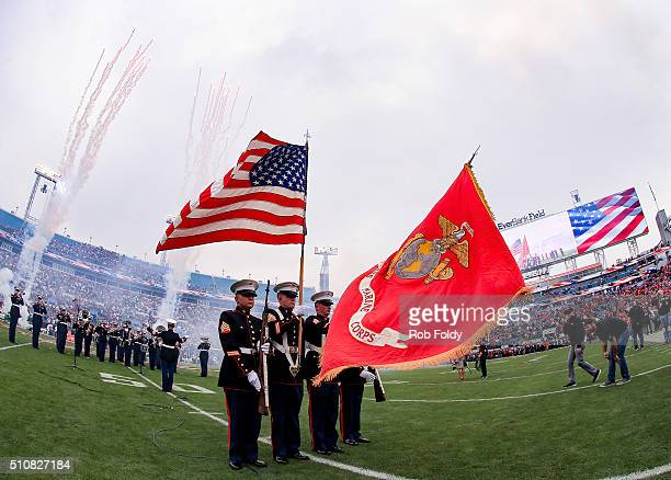Members of the United States Marine Corps hold flags before the TaxSlayer Bowl game between the Georgia Bulldogs and the Penn State Nittany Lions at...