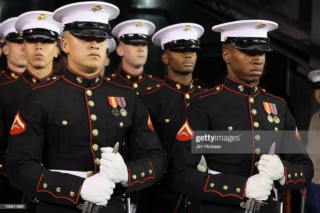 Members of the United States Marine Corps silent drill team look on before performing as the New York Giants play against the Pittsburgh Steelers at...