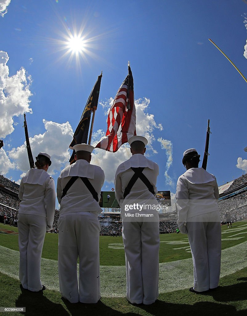 Members of the United States Navy present the colors during a game between the Jacksonville Jaguars and the Green Bay Packers at EverBank Field on September 11, 2016 in Jacksonville, Florida.