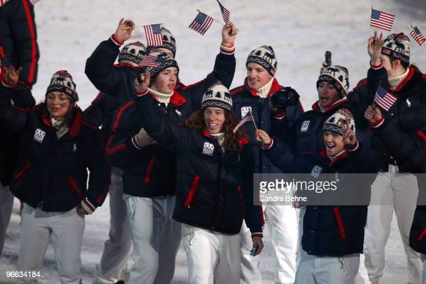 Members of the United States Olympic team including snowboarder Shaun White wave to the crowd during the Opening Ceremony of the 2010 Vancouver...