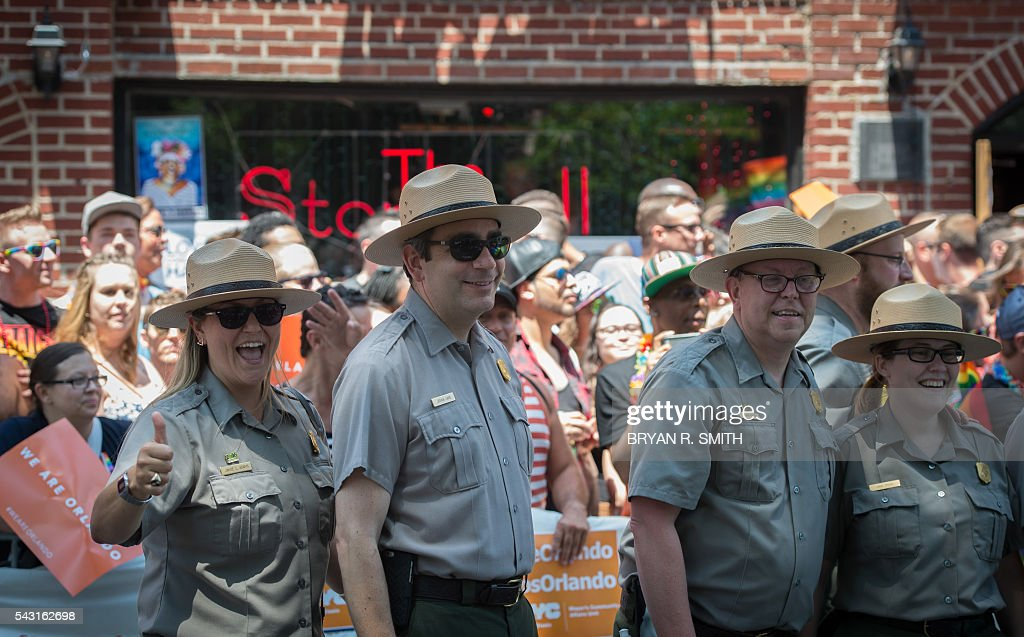 Members of the United States Park Service walk past the Stonewall Inn during the 46th annual Gay Pride march June 26, 2016 in New York. New York kicked off June 26 what organizers hope will be the city's largest ever Gay Pride march, honoring the 49 people killed in the Orlando nightclub massacre and celebrate tolerance. / AFP / the 46th / Bryan R. Smith