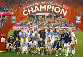 Members of the United States pose on the field after they beat Canada 20 during the Championship final of the 2016 CONCACAF Women's Olympic...