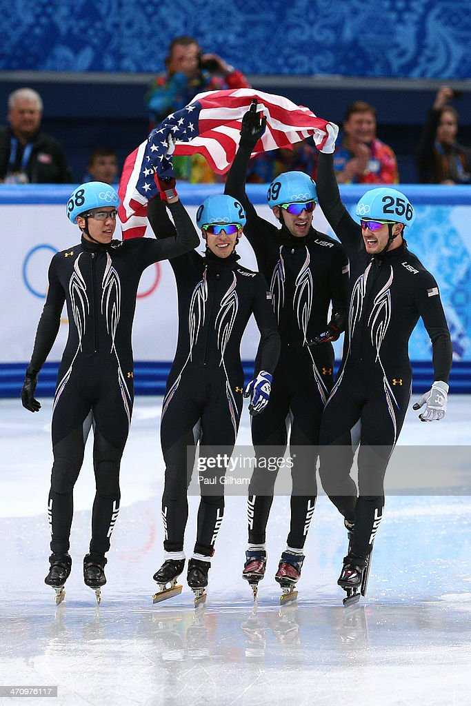 Members of the United States short track team celebrate winning the silver medal in the Short Track Men's 5000m Relay on day fourteen of the 2014...
