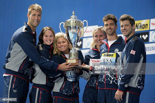 Members of the United States team pose with the Best Swimming team award on day sixteen of the 16th FINA World Championships at the Kazan Arena on...