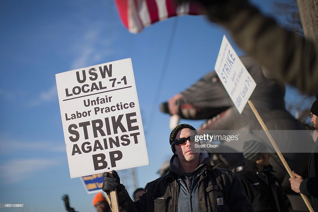 Members of the United Steelworkers Union and other supporting unions picket outside the BP refinery on February 10 2015 in Whiting Indiana Workers at...