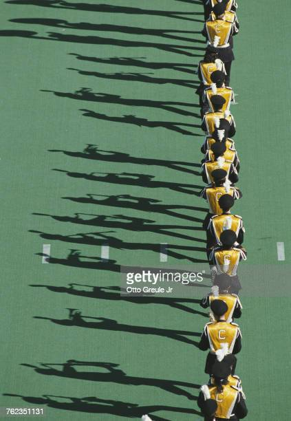 Members of the University of California Berkeley marching band play to their own shadows before the NCAA Division IA Pacific10 Conference game...
