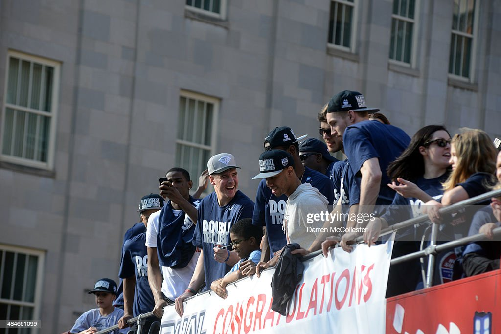 Members of the University of Connecticut men's basketball team ride in a victory parade to celebrate their national championship April 13, 2014 in Hartford, Connecticut. This year was the second time both the men's and women's Uconn basketball teams have won national championships in the same year.